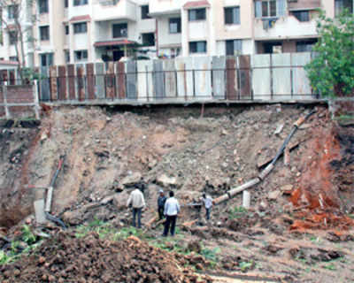 Developer's excavation uproots society's trees, boundary wall caves in