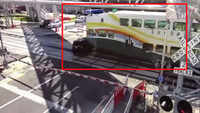Surveillance shows Florida commuter train crashing into SUV