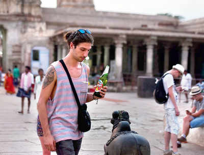Tourist has liquor inside Hampi temple, triggers huge protests