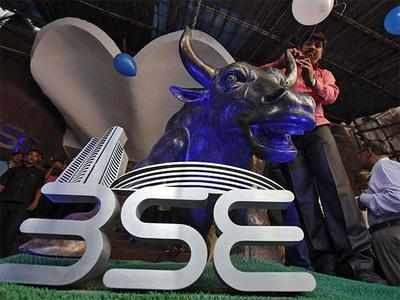 Sensex retreats from record level, plunges by 207 pts
