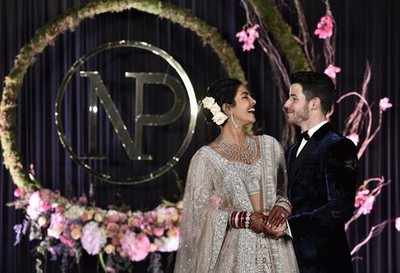 In pics: Priyanka Chopra dazzles in red for reception after Hindu wedding