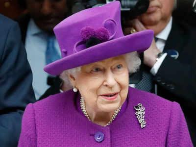Queen's aide tests positive