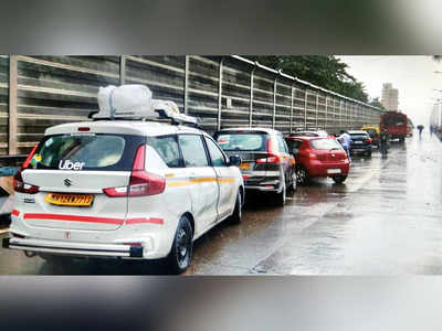 Traffic jams dot the city as cabs park along road medians
