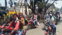 Bolpur: TMC workers brandishing weapons during bike rally