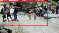 Watch: Locals cross overflowing water stream using ropes in Uttarkashi