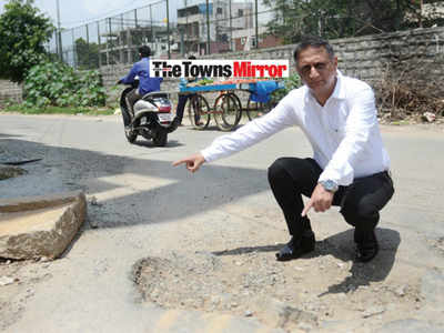 The Towns Mirror Special: Potholes make this a hell hole