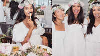 Inside Lisa Haydon's all-white baby shower with flowers and cakes