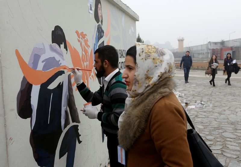 Afghanistan's ArtLords daub walls with messages of defiance, hope