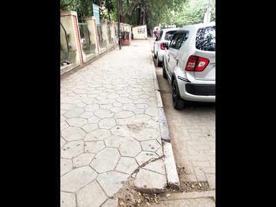 Broken signboard at Shivajinagar cleared