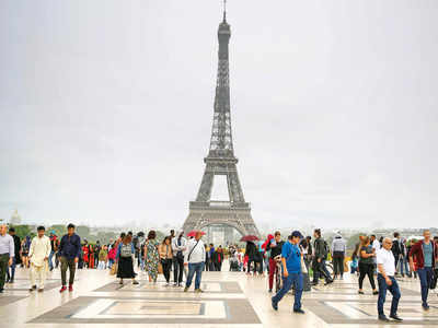 Eiffel Tower reopens to visitors after 104 days