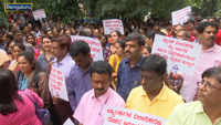 Public sector bank employees stage mass protest against merger of PSUs