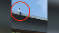 On cam: Man hangs self from bridge at Kalwa, rescued