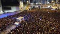 Hong Kong: Protesters allow ambulance to pass through massive protest march