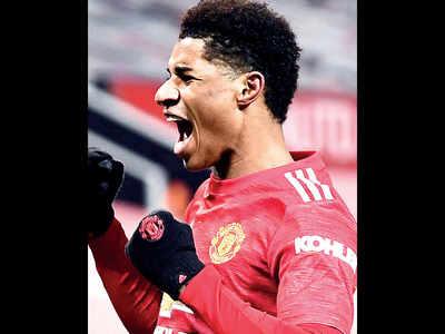 United go second as Rashford sinks Wolves