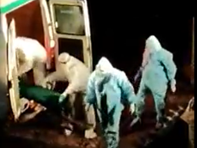 Andhra Pradesh: Civic staff in Nellore take four bodies in earth mover, dump in one pit at night
