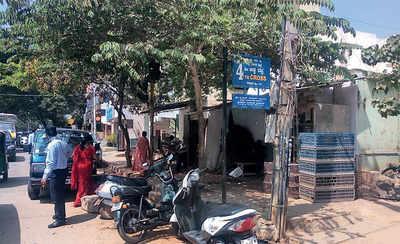 Shop blocks parking space on public road