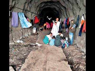Stranded by the storm, villagers take shelter in unused train tunnel