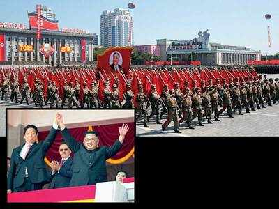 N Korea holds military parade without missiles