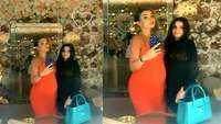 Amy Jackson is glowing as she flaunts baby bump in a body hugging orange dress