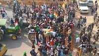 Tractor rally: Farmers enter Delhi from Chilla border, break police barricade