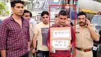 Criminal surrenders wearing placard saying 'don't shoot me' in UP's Amroha