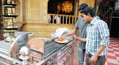 Temples say a little prayer, keep donation boxes clamped