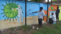 Covid-19: Artists give final touches to wall paintings of corona warriors in Vizag