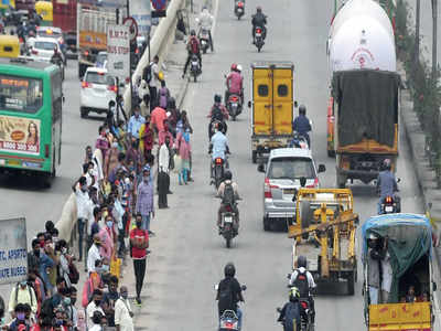 Buses drive by as covid norms limits passengers