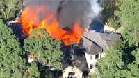 Fire destroys massive Texas mansion, 2 hurt