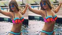 Kim Sharma flaunts belly button piercing in neon bikini