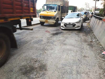 Traffic congestion due to potholes on flyover