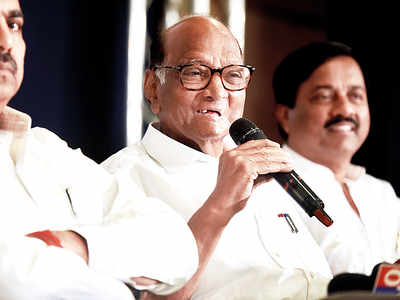 Pawar rules out any role; Raut cosies up with Cong