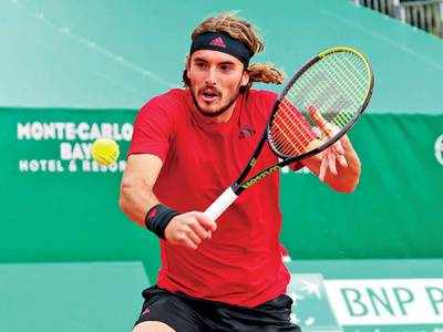 Sleek Tsitsipas brushes aside Rublev for Monte Carlo title
