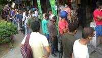 People flock to liquor shops in Kolkata ahead of lockdown