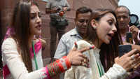 Actresses turned MPs, Nusrat Jahan and Mimi Chakraborty, mobbed by media, say 'don't push'
