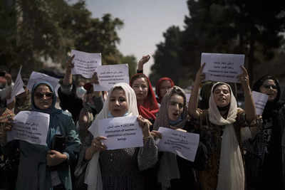 Afghanistan crisis live updates: Afghan activists protest outside shuttered women affairs ministry