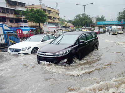 Knee-deep in water on first day of monsoon