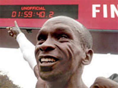 Marathon's great wall breached by Kenya's Eliud Kipchoge