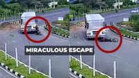 Viral video: Biker run over by a bus, escaped unhurt
