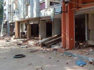 AMC razes illegal shops in Satellite, residents reclaim parking after 17 yrs