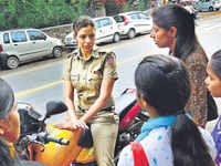 Women riding two-wheelers without wearing a helmet will be fined Rs 300/-