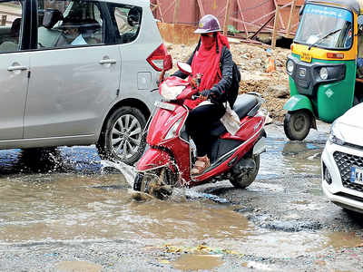 Bannerghatta Road is full of potholes and sewage, causing mile-long traffic jams