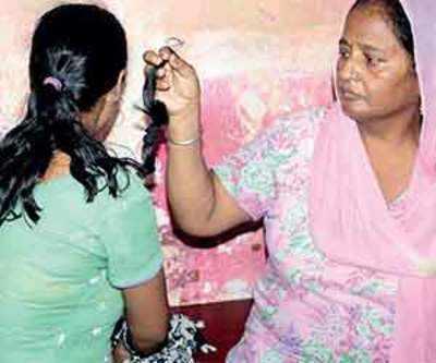 Women's braids cut off in Uttar Pradesh