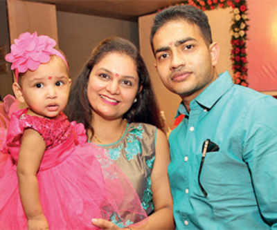 NRI couple adopts abandoned 15 month old girl