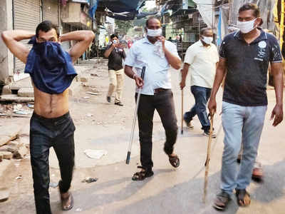 Police personnel hit man, force him to use shirt as mask