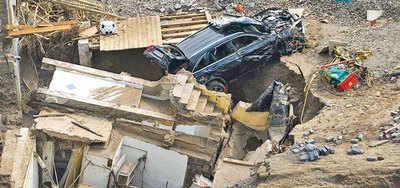 Death toll crosses 180, rescuers dig deeper