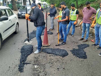 Bengalureans come together to fill potholes