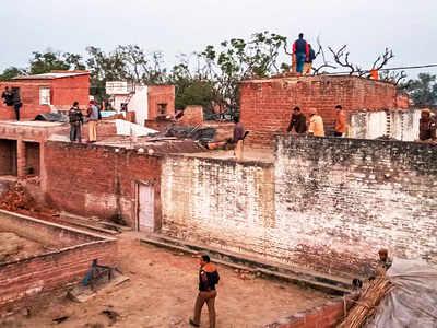20 children held hostage by murder accused in UP village