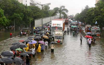 Rains halt Mumbai, commuters hit hard as trains cancelled
