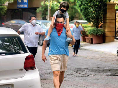 Mask on: Saif Ali Khan, Taimur step out in Bandra on Sunday